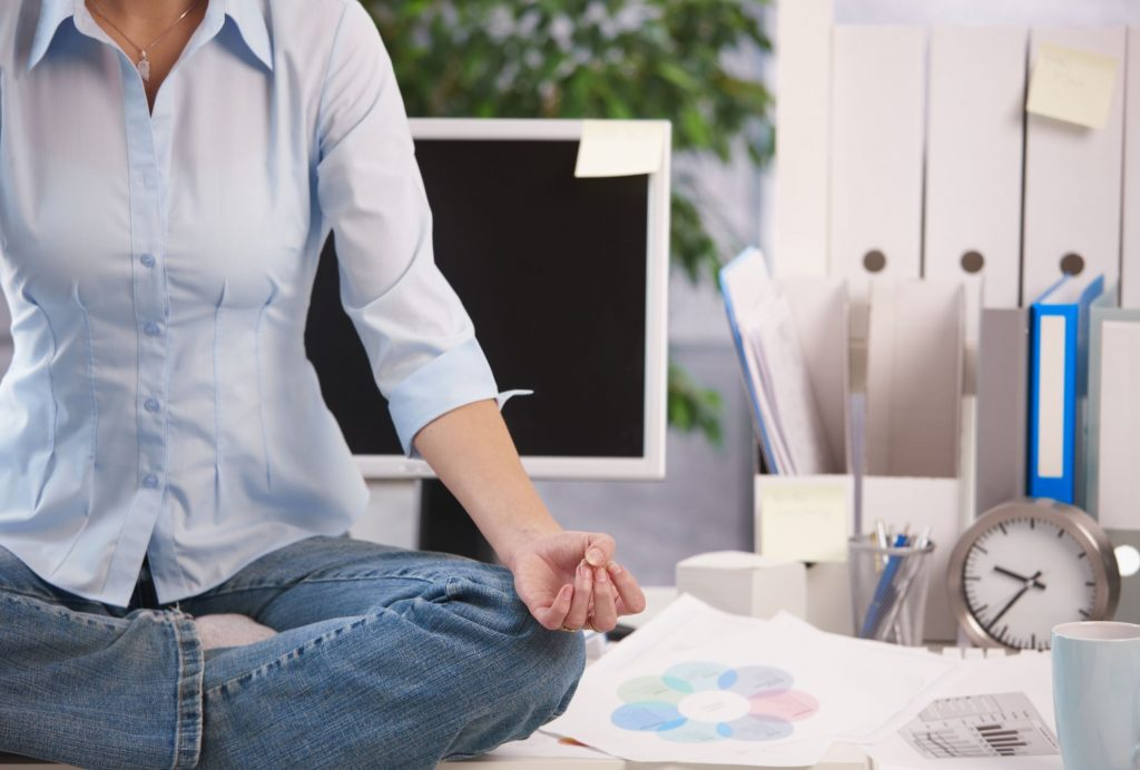 office-desk-meditation-StockLib-56a905493df78cf772a2e2f9